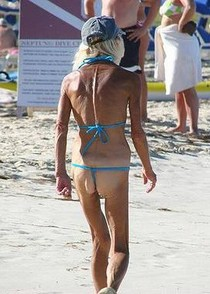 Skinny old lady on the beach