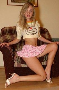 Amazing blonde teen in skirt in this homemade sexy photo.