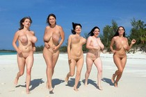 Run boobies run! Busty brunettes shaking their huge tits on the beach