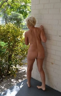 Mature woman naked in public.