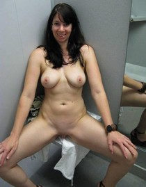 Brunette in changing room naked with shaved pussy.