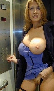 Milf with big breasts flashes pussy in elevator